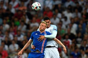 Iceland's forward Kolbeinn Sigthorsson (L) vies for the ball against England's defender Chris Smalling during Euro 2016 round of 16 football match between England and Iceland at the Allianz Riviera stadium in Nice on June 27, 2016.   / AFP PHOTO / PAUL ELLISPAUL ELLIS/AFP/Getty Images