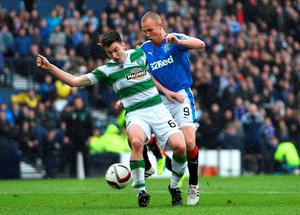 GLASGOW, SCOTLAND - APRIL 17:   Nir Bitton of Celtic holds off pressure from  Kenny Miller of Rangers during the William Hill Scottish Cup semi final between Rangers and Celtic at Hampden Park on April 17, 2016 in Glasgow, Scotland.  (Photo by Jeff J Mitchell/Getty Images)