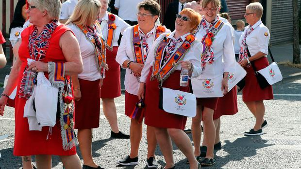 Orangewomen take part in the annual July 12 parade in Belfast, on July 12, 2017. July 12 is the main marching day in the Orange Order calendar. The parades mark the Protestant commemoration of the 327th anniversary of King William III's victory at the Battle of the Boyne in 1690. / AFP PHOTO / Paul FAITHPAUL FAITH/AFP/Getty Images