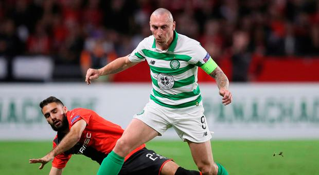 Moving on: Scott Brown goes on the attack for Celtic in France
