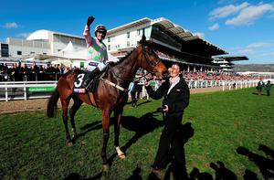 Ruby Walsh celebrates on board Douvan after winning The Sky Bet Supreme Novices' Hurdle Race during Day One of the Cheltenham Festival