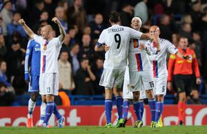 LONDON, ENGLAND - SEPTEMBER 18:  Marco Streller of FC Basel and Behrang Safari of FC Basel celebrate victory at the final whistle during the UEFA Champions League Group E Match between Chelsea and FC Basel at Stamford Bridge on September 18, 2013 in London, England.  (Photo by Ian Walton/Getty Images)