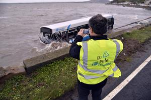 Wednesday  9th December 2015   NO BYLINE  A bus has landed on a beach after crashing on the Portaferry Road near Newtownards, County Down. Translink said no passengers were on board the bus and no other vehicles were involved.  It said the driver had been taken to hospital to be assessed and an investigation was ongoing.
