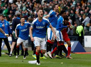 Rangers' players mob goal keeper Wes Foderingham as they celebrate victory after the William Hill Scottish Cup semi-final match at Hampden Park, Glasgow. PRESS ASSOCIATION Photo. Picture date: Sunday April 17, 2016. See PA story SOCCER Rangers. Photo credit should read: Danny Lawson/PA Wire. EDITORIAL USE ONLY