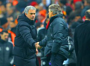 Jose Mourinho manager of Chelsea shakes hands with Head Coach Roberto Mancini of Galatasaray at the final whistle during the UEFA Champions League Round of 16 first leg match between Galatasaray AS and Chelsea at Ali Sami Yen Arena on February 26, 2014 in Istanbul, Turkey.  (Photo by Michael Regan/Getty Images)