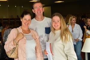Pacemaker Press Intl 150819  Pupils at Lagan College celebrate their A Level results today.  This year was Lagan's best year ever with students receiving a 10% rise in grades. Pictured is Kaitlyn Cairnduff with Mum & Dad celebrating their results . Photo David McCormick/Pacemaker Press