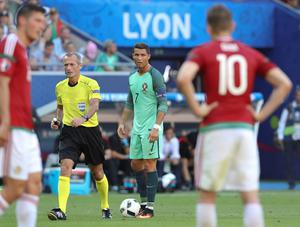 Portugal's Cristiano Ronaldo, center, stands on the pitch during the Euro 2016 Group F soccer match between Hungary and Portugal at the Grand Stade in Decines-Charpieu, near Lyon, France, Wednesday, June 22, 2016. (AP Photo/Laurent Cipriani)
