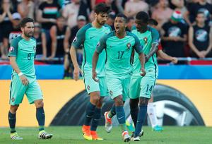 Portugal's Nani, second from right, celebrates after scoring his sides first goal during the Euro 2016 Group F soccer match between Hungary and Portugal at the Grand Stade in Decines-Charpieu, near Lyon, France, Wednesday, June 22, 2016. (AP Photo/Darko Bandic)