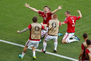 Hungary's Zoltan Gera , center, is congratulated after scoring his side's first goal during the Euro 2016 Group F soccer match between Hungary and Portugal at the Grand Stade in Decines-Charpieu, near Lyon, France, Wednesday, June 22, 2016. (AP Photo/Michael Sohn)