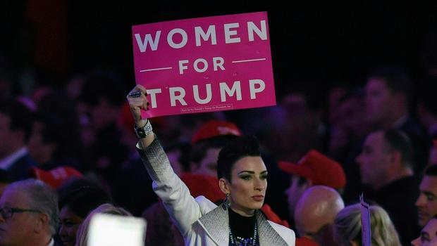 A supporter of Republican presidential nominee Donald Trump flashes a sign during election night at the New York Hilton Midtown in New York on November 9, 2016.  / AFP PHOTO / Timothy A. CLARYTIMOTHY A. CLARY/AFP/Getty Images