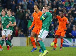Northern Ireland captain Steven Davis takes a penalty which he fails to score as Netherlands captain Virgil van Dijk looks on.    Picture by Jonathan Porter/PressEye
