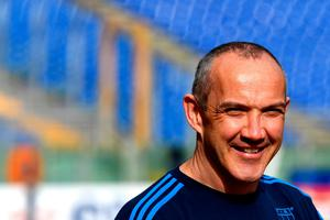 """Italy's national team coach from Ireland, Conor O'Shea, attends the """"Captain Run"""" training on the eve of the Six Nations rugby union match Italy vs Wales, on February 4, 2017 at the Olympic stadium in Rome.  / AFP PHOTO / ALBERTO PIZZOLIALBERTO PIZZOLI/AFP/Getty Images"""