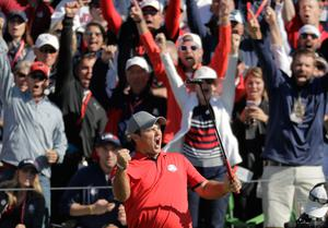 United StatesÄô Patrick Reed reacts after making a putt and winning his match 3 & 2 on the 16th hole during a foresomes match at the Ryder Cup golf tournament Friday, Sept. 30, 2016, at Hazeltine National Golf Club in Chaska, Minn. (AP Photo/Charlie Riedel)