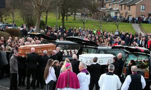 Coffins are place into hearses at the Holy Family church, Ballymagroarty in Londonderry after the funeral of the five people who were killed when their car slid off a slipway in Co Donegal. PRESS ASSOCIATION Photo. Picture date: Thursday March 24, 2016. Sean McGrotty and his sons Mark, 12, and Evan, eight, died along with his mother-in-law Ruth Daniels, 57, and her 14-year-old daughter Jodie Lee Daniels after their SUV sank after sliding off the pier slipway in Buncrana, Co Donegal. See PA story FUNERAL Pier. Photo credit should read: Brian Lawless/PA Wire