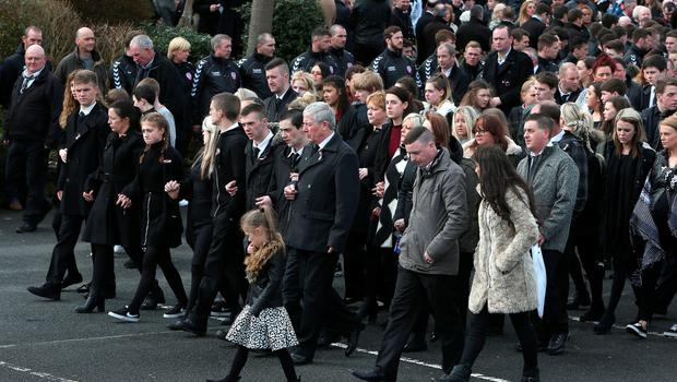 Mourners arrive at the Holy Family church, Ballymagroarty in Londonderry for the funeral of the five people killed when their car slid off a slipway in Co Donegal. PRESS ASSOCIATION Photo. Picture date: Thursday March 24, 2016. Sean McGrotty and his sons Mark, 12, and Evan, eight, died along with his mother-in-law Ruth Daniels, 57, and her 14-year-old daughter Jodie Lee Daniels after their SUV sank after sliding off the pier slipway in Buncrana, Co Donegal. See PA story FUNERAL Pier. Photo credit should read: Brian Lawless/PA Wire