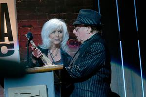 Van Morrison receiving with the Lifetime Achievement for Songwriter award from Emmylou Harris