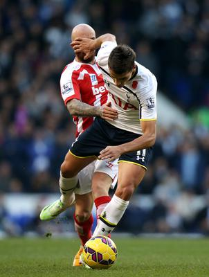 Tottenham Hotspur's Erik Lamela, (right) battles for the ball with Stoke City's Stephen Ireland, (left)  during the Barclays Premier League match at White Hart Lane, London. John Walton/PA Wire.