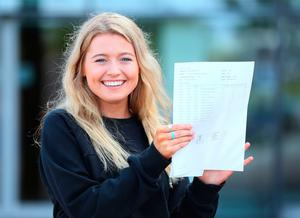 Doireann Sheridan after collecting her A-level results at Our Lady and Saint Patrick's College, Belfast. PRESS ASSOCIATION Photo. Picture date: Thursday August 17, 2017. See PA story EDUCATION Alevels Ulster. Photo credit should read: Brian Lawless/PA Wire