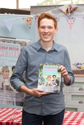 Andrew Smyth with Bake Off book