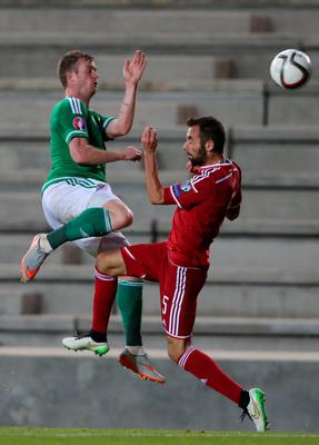 Northern Ireland's Chris Brunt and Hungary's Attila Fiola battle for the ball during the UEFA European Championship Qualifying match at Windsor Park, Belfast. PRESS ASSOCIATION Photo. Picture date: Monday September 7, 2015. See PA story SOCCER N Ireland. Photo credit should read: Niall Carsony/PA Wire