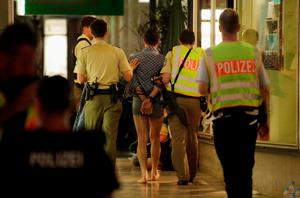 MUNICH, GERMANY - JULY 22:  Police arrest three men, whose identities and roles were not yet confirmed, near Marienplatz square following a rampage shooting in the city on July 22, 2016 in Munich, Germany. Several people have been killed and an unknown number injured in a shooting at a shopping centre at the Olympia Einkaufzentrum (OEZ).  (Photo by Johannes Simon/Getty Images)