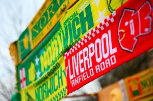 NORWICH, ENGLAND - JANUARY 23: Matchday scarf is on sale at a stall outside the stadium prior to the Barclays Premier League match between Norwich City and Liverpool at Carrow Road on January 23, 2016 in Norwich, England.  (Photo by Clive Mason/Getty Images)