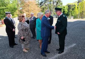 Police Service of Northern Ireland Chief Constable George Hamilton  greets the Prince of Wales as he attends the PSNI HQ memorial garden opening in Belfast, during their visit to Northern Ireland. Brian Lawless/PA Wire