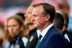 Michael O'Neill manager of Northern Ireland looks on prior to the UEFA EURO 2016 Group C match between Poland and Northern Ireland at Allianz Riviera Stadium. (Photo by Laurence Griffiths/Getty Images)
