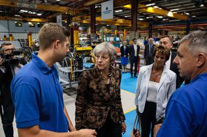 """Theresa May, seen touring a factory in Guildford, said """"we will take back control of our laws"""" (Jack Taylor/PA)"""