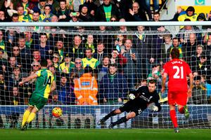 NORWICH, ENGLAND - JANUARY 23:  Wes Hoolahan (L) of Norwich City converts the penalty to score his team's third goal during the Barclays Premier League match between Norwich City and Liverpool at Carrow Road on January 23, 2016 in Norwich, England.  (Photo by Clive Mason/Getty Images)