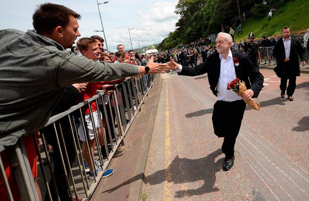 Britain's main opposition Labour Party leader Jeremy Corbyn greets supporters as he leaves after attending a campaign visit in Colwyn Bay, north Wales on June 7, 2017, on the eve of the general election. Britain on Wednesday headed into the final day of campaigning for a general election darkened and dominated by jihadist attacks in two cities, leaving forecasters struggling to predict an outcome on polling day. / AFP PHOTO / Oli SCARFFOLI SCARFF/AFP/Getty Images