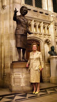 File photo dated 21/2/07 of Former British Prime Minister Baroness Margaret Thatcher in front of a bronze statue of herself, inside the Palace of Westminster, London. PRESS ASSOCIATION Photo. Issue date: Monday April 8, 2013. Baroness Thatcher died this morning following a stroke, her spokesman Lord Bell said. See PA story DEATH Thatcher. Photo credit should read: Johnny Green/PA Wire