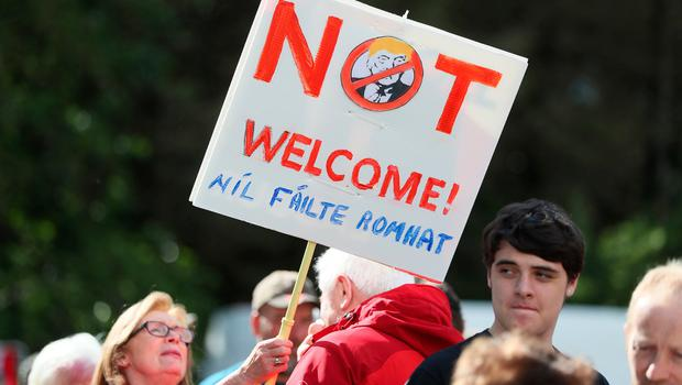 Protestors stand at the peace camp on the road to Shannon Airport following the arrival of US President Donald Trump for his visit to the Republic of Ireland. PRESS ASSOCIATION Photo. Picture date: Wednesday June 5, 2019. See PA story IRISH Trump. Photo credit should read: Brian Lawless/PA Wire