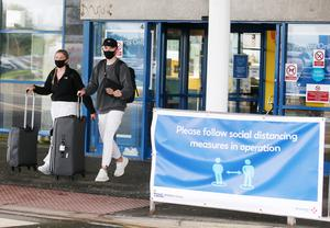 Passengers traveling on a flight from Malaga, in Spain, arriving at Belfast International Airport on Sunday morning.  Picture by Jonathan Porter/PressEye