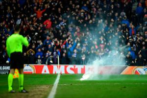 Punished: Fireworks were thrown at Rangers' game with Braga