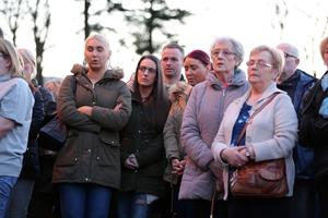 Press Eye - Belfast - Northern Ireland 19th April 2016  Photo by Kelvin Boyes / Press Eye. Members of the public at a vigil in the grounds of Holy Cross Church, Ardoyne, in support of the family of taxi driver  and father-of-four Michael McGibbon who was shot dead in North Belfast at the weekend.
