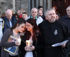PACEMAKER BELFAST   19/04/2016 Joanne McGibbon with her young daughter at the candle light vigil that was held at Holy Cross Church last night in support of her husband Michael who was murdered earlier this week