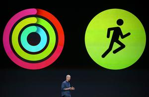 Apple CEO Tim Cook announces fitness apps for the new iPhone 6 and Apple Watch during an Apple special event at the Flint Center for the Performing Arts on September 9, 2014 in Cupertino, California. Apple unveiled the Apple Watch wearable tech and two new iPhones, the iPhone 6 and iPhone 6 Plus.  (Photo by Justin Sullivan/Getty Images)