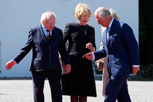 Ireland's President, Michael D Higgins (L) and his wife Sabina (2nd L), greet Britain's Prince Charles, Prince of Wales and his wife Britain's Camilla, Duchess of Cornwall at Aras an Uachtarain, the official residence of the President, in Pheonix Park, Dublin, on May 10, 2017. / AFP PHOTO / PAUL FAITHPAUL FAITH/AFP/Getty Images