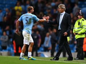 MANCHESTER, ENGLAND - AUGUST 19:  Manuel Pellegrini the manager of Manchester City shakes hands with Pablo Zabaleta after the Barclays Premier League match between Manchester City and Newcastle United at the Etihad Stadium on August 19, 2013 in Manchester, England.  (Photo by Alex Livesey/Getty Images)