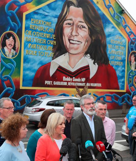 Sinn Fein's Northern Ireland leader Michelle O'Neill (centre left) and party president Gerry Adams (centre) speaking outside Sinn Fein offices on the Falls Road in Belfast after the party emerged with seven MPs following the General Election. PA