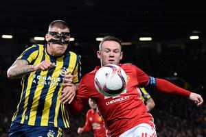 Fenerbahce's Slovakian defender Martin Skrtel (L) challenges Manchester United's English striker Wayne Rooney (R) during the UEFA Europa League group A football match between Manchester United and Fenerbahce at Old Trafford in Manchester, north west England, on October 20, 2016. AFP/Getty Images