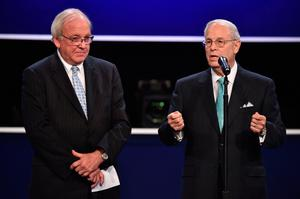 Co-chairs for the Commission on Presidential Debates, Frank J. Fahrenkopf, Jr. (R), and Michael D. McCurry (L) speak prior to the third and final US presidential debate between Democratic nominee Hillary Clinton and Republican nominee Donald Trump at the Thomas & Mack Center on the campus of the University of Las Vegas in Las Vegas, Nevada on October 19, 2016. / AFP PHOTO / Paul J. RichardsPAUL J. RICHARDS/AFP/Getty Images