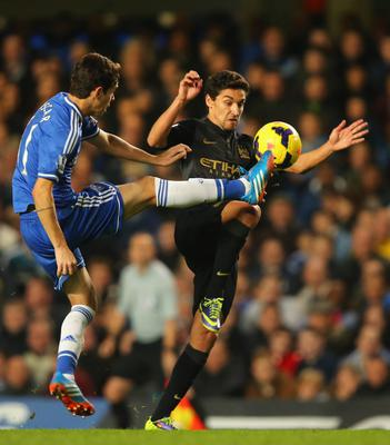 LONDON, ENGLAND - OCTOBER 27:  Oscar of Chelsea and Jesus Navas of Manchester City compete for the ball compete for the ball during the Barclays Premier League match between Chelsea and Manchester City at Stamford Bridge on October 27, 2013 in London, England.  (Photo by Clive Rose/Getty Images)