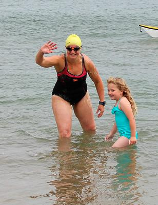 Handout photo of Heather Clatworthy with daughter Lily before she began her 13 mile swim from Stroove in Co Donegal to Portstewart in Northern Ireland. PA
