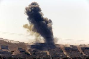 Smoke rises after a shell lands in Kobani in Syria as fighting intensifies between Syrian Kurds and the militants of Islamic State group, as seen from the outskirts of Suruc, at the Turkey-Syria border, Monday, Oct. 6, 2014. Kobani, also known as Ayn Arab and its surrounding areas have been under attack since mid-September, with militants capturing dozens of nearby Kurdish villages. (AP Photo/Lefteris Pitarakis)