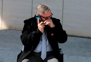 WARRINGTON, ENGLAND - APRIL 26:  A relative of the Hillsborough victims talks on the phone as he departs Birchwood Park after hearing the conclusions of the Hillsborough inquest on April 26, 2016 in Warrington, England. The fresh inquests into the 1989 Hillsborough disaster, in which 96 football supporters were crushed to death, concluded on April 26, 2016 with a verdict of unlawful killing, after the initial verdicts were quashed. Relatives of Liverpool supporters who died in Britain's worst sporting disaster gathered in the purpose-built court to hear the jury's verdict in Warrington after a 25 year fight to overturn the accidental death verdicts handed down at the initial 1991 inquiry.  (Photo by Dave Thompson/Getty Images)