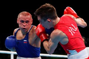 RIO DE JANEIRO, BRAZIL - AUGUST 16:  Vladimir Nikitin (L) of Russia throws a left on Michael John Conlan of Ireland in the boxing  Men's Bantam (56kg) Quarterfinal 1 on Day 11 of the Rio 2016 Olympic Games at Riocentro on August 16, 2016 in Rio de Janeiro, Brazil.  (Photo by Christian Petersen/Getty Images)