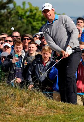 Irish golfer Padraig Harrington plays out of the rough onto the 18th green on the second day of the Irish Open at the Royal County Down Golf Club in Newcastle in Northern Ireland on May 29, 2015.      AFP PHOTO / PAUL FAITHPAUL FAITH/AFP/Getty Images