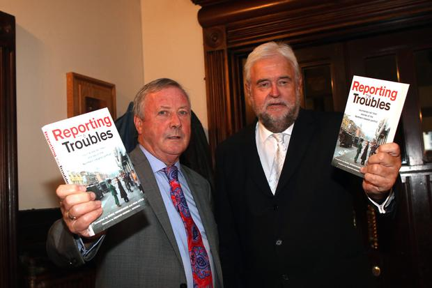 INVALUABLE: Deric Henderson and Ivan with their Troubles book